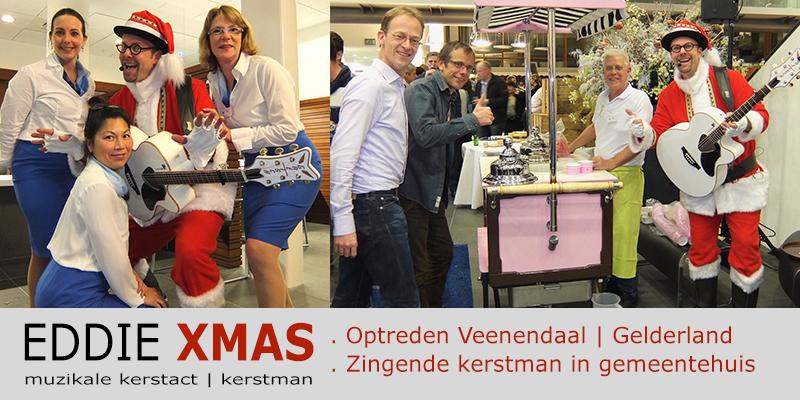 Zingende kerstman 2015 | Veenendaal Gelderland | Gemeentehuis | Muzikale kerstman inhuren | Eddie Xmas | kerst troubadour boeken | kerst-act christmas