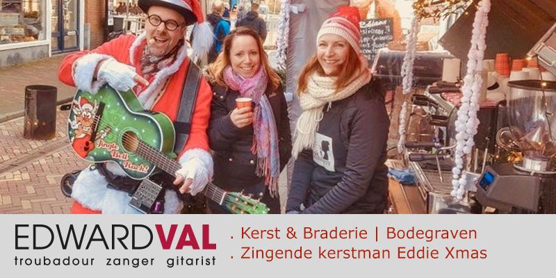 Bodegraven 2 | promotie winkelstraat winkelcentrum zingende kerstman eddie xmas optreden braderie markt edward val zang gitaar mobiel entertainer