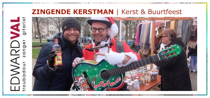 Buurtfeest | zingende kerstman boeken kerstact edward val troubadour zanger gitarist mobiele muzikant braderie