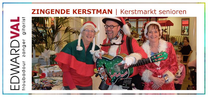 Kerstmarkt senioren2 | muzikale kerstman inhuren troubadour edward val muzikant zanger gitarist kerstsfeer kerstliedjes