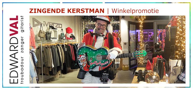 Winkelpromotie | leuke gezellige kerstman met gitaar kersrtmarkt senioren zorgcentrum kerstborrel troubadour edward val nijkerk